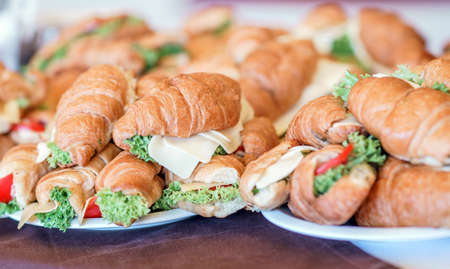 Butter croissants with chicken ham, cheese and parsley on white plate.Croissant sandwich with cheese and vegetables for healthy snack.Appetizer Reklamní fotografie