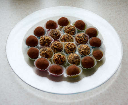Delicious Chocolate Truffles with Rum and Nuts.Close up of colorful healthy homemade candies with nuts.Set of different kinds of delicious dessert