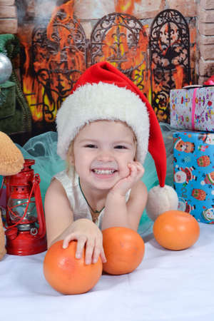 Cute little girl with Christmas presents