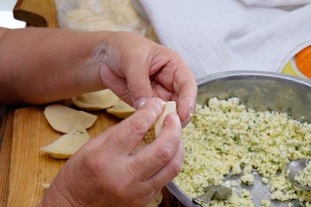 modeling: Modeling of homemade delicious vareniki, dumpling or pelmeni . Close Up. Stock Photo