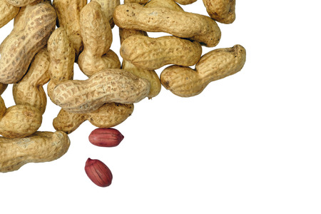 Dried peanuts in closeup isolatd on white background. Top View. Space for text Stock Photo