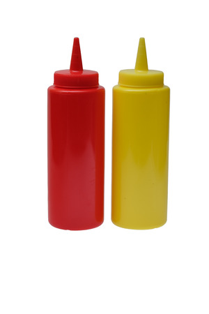 squirting ketchup: Red plastic ketchup and yellow mustard plastic bottle isolated on white background. Stock Photo