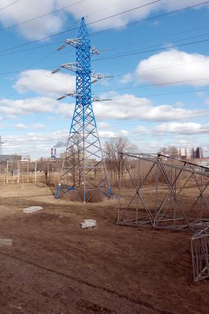 High voltage transmission towers on nature landscape