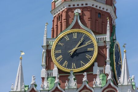 Clock on Spassky Tower on Red Square. Moscow, Russia Close up photo