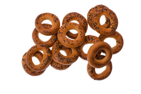 A dry bagels isolated on white background. Selective focus on top dry bagel