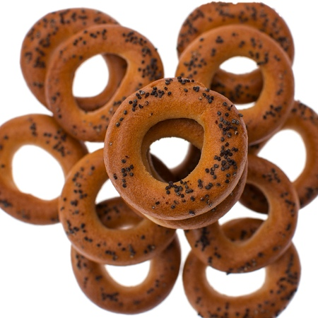 boublik: A dry bagels isolated on white background. Selective focus on top dry bagel. Close up image