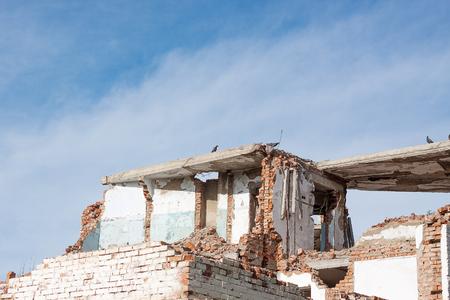 The old destroyed brick multi-storey building. Destroyed Ruined Building. Asubulak, Kazakhstan Stock Photo