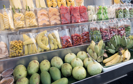 Different kind of tropical fruits. Cutting Fruits.