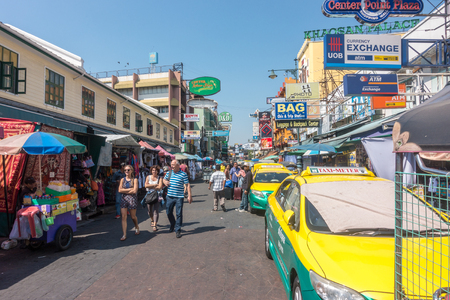 BANGKOK, THAILAND - December 21 2017: Backpackers and Tourists walk on Khao San Road in Bangkok, Thailand. Khao San Road is a famous low budget hotels and guesthouses area in Bangkok.