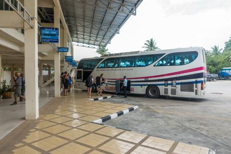 KOH SAMUI, THAILAND - December 20, 2017: Bus Terminal Samui. Tourists load luggage on the bus Editorial