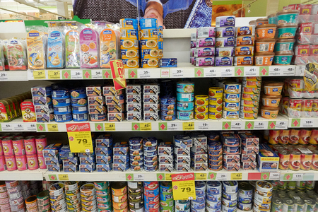 KOH SAMUI, THAILAND - December 13, 2017: Big C Supercenter. Various types of canned fish on the shelf in the supermarket