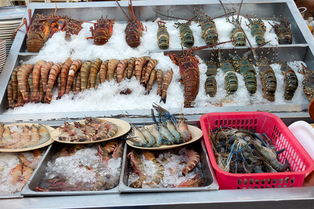 Different types of seafood lined on ice, Hua Hin market, thailand