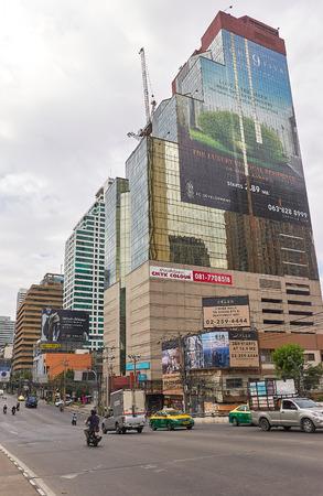 BANGKOK, THAILAND - December 5: Traffic at Asoke intersection during morning, Bangkok. Vertical image