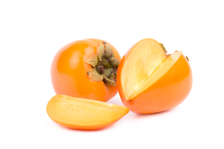 Persimmon fruit on a white background. Pieces of fruit