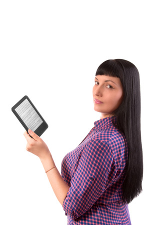 Girl reading an e-book on a white background