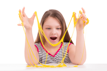 Girl playing with slime on a white background