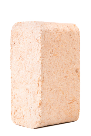 holzbriketts: Briquettes made of sawdust lie on a white background.