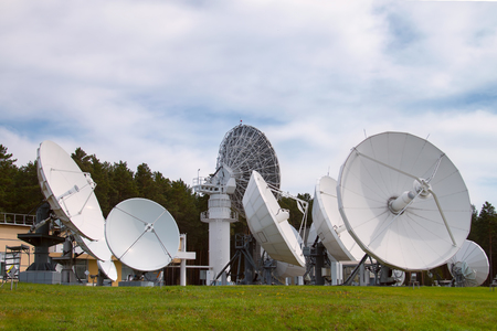 Base with satellite dishes aimed into space
