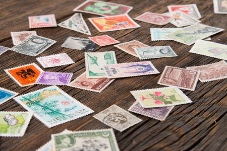 Collection of postage stamps. Postage stamps on the table. Philatelism Stock fotó