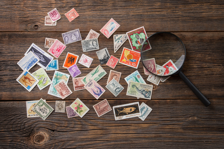Collection of postage stamps. Postage stamps on the table. Philatelism Stock Photo