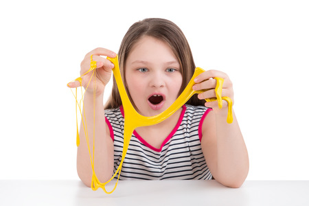 Girl playing with mucus on white background