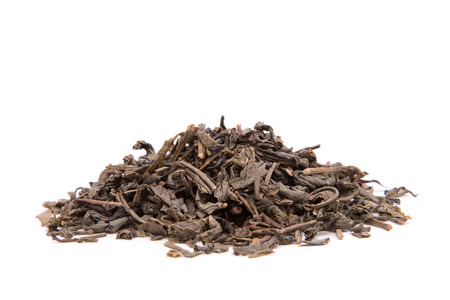 A strewed pile of green tea on a white background