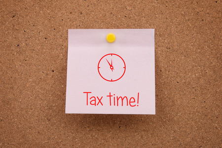 Time taxes. A reminder of the time of payment of taxes pinned on the board in the office