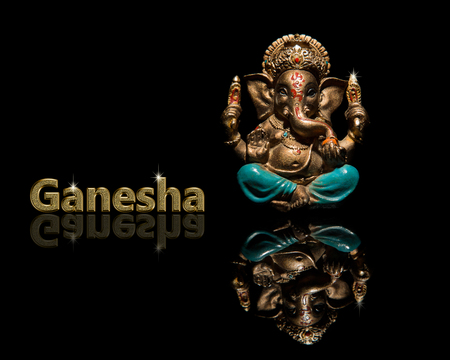 God of Ganesha with reflection on the surface. God of Ganesha with reflection on the surface. The deity of Ganesha on a black background Stock Photo - 84801064