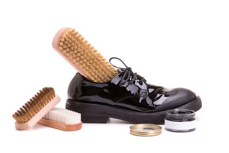 Leather shoes with a set for shoe service on a white background. Shoe care