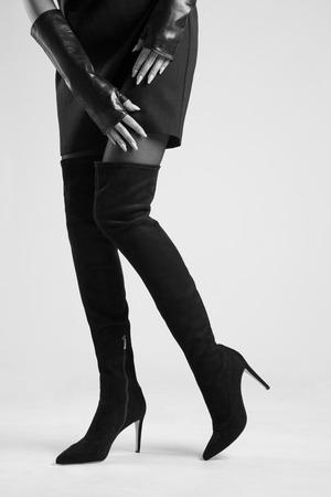 Girl in Hessian boots in high heels in studio Stock Photo