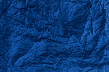 Background of dark blue crumpled paper