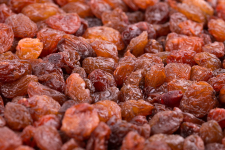 Fresh raisins close-up. Background of natural raisins