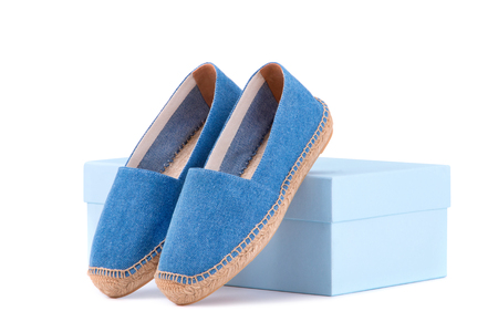 Espadrilles on the shoe box. Blue espadrilles on a white background