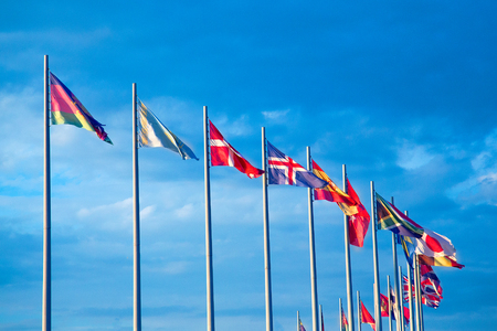 Flags of the world against the blue sky with clouds Stock Photo