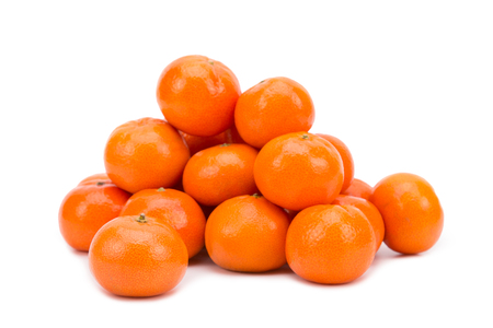 A pile of ripe tangerines on a white background.