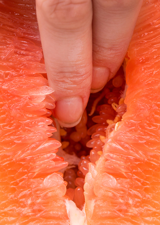 The vagina symbol. Two fingers in grapefruit. Masturbation. Sex concept. Zdjęcie Seryjne