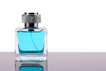 Male perfume on a dark mirror surface close-up. 스톡 콘텐츠 - 118656379