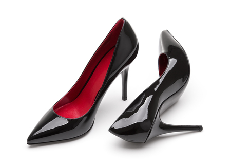 Black patent leather high-heeled shoes. Stock Photo
