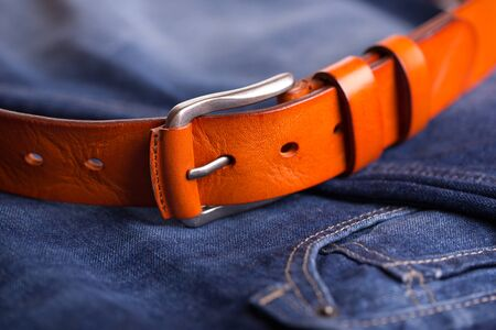Leather belt on blue jeans. 版權商用圖片