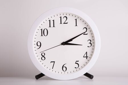 Watch with a large round dial on a light background.