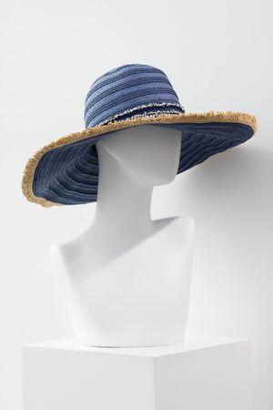 Mannequin in a summer straw hat.