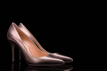 Beautiful high-heeled shoes. Womens shoes on a black background.
