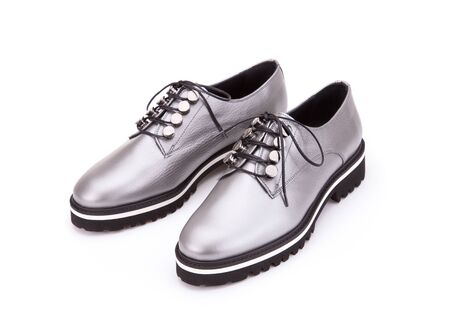 Silver shoes from silvery skin isolate on a white background.