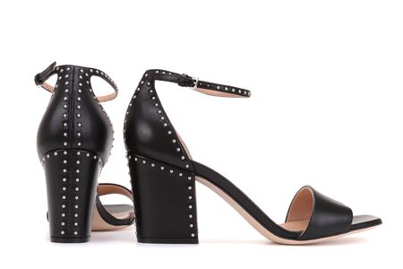 Fashionable shoes with a steady heel decorated with metal rivets.
