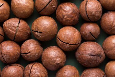 Whole macadamia nuts. A lot of nuts closeup.
