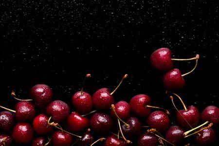 Ripe cherry on a black background.