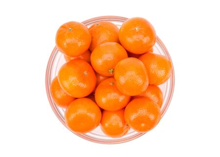 Tangerines in a plate isolate on a white background. Stok Fotoğraf