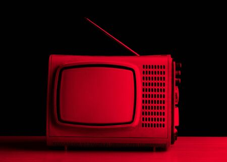 Old TV on a dark background.