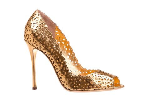Golden high heel shoes isolate on white background.