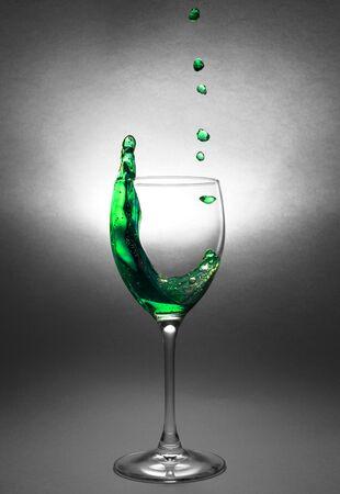 Splash of liquid in a glass goblet. Stok Fotoğraf